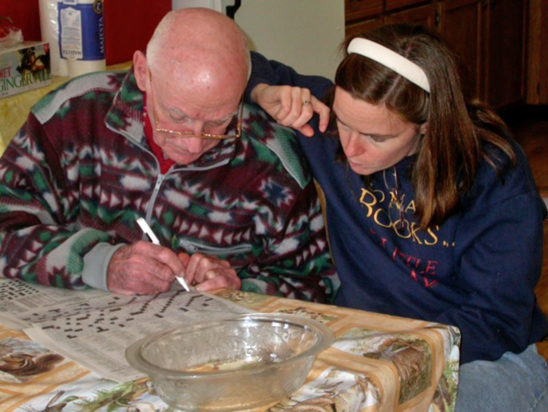 Dad and I working on a crossword puzzle.
