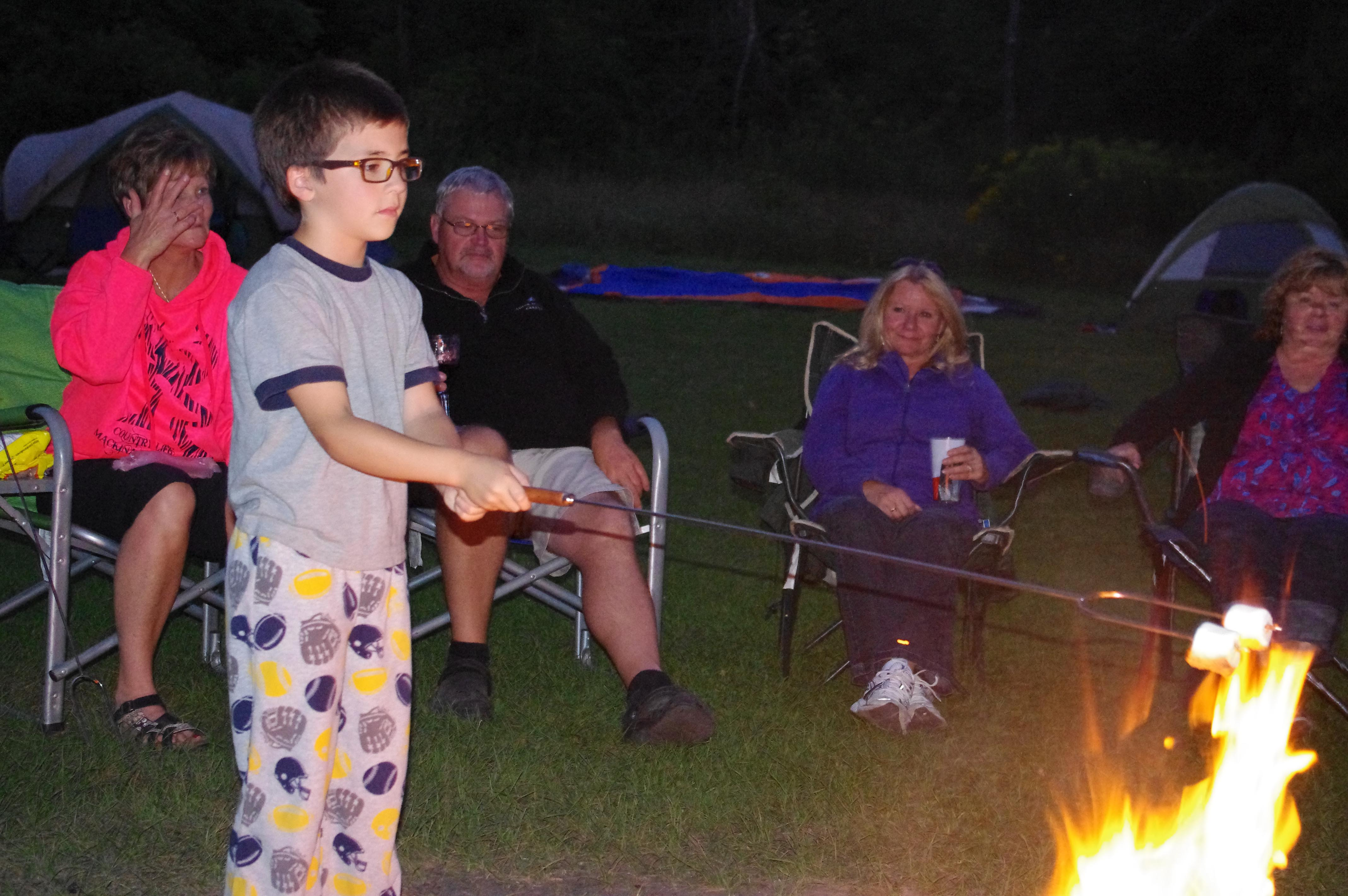 Roasting Marshmellows around an open campfire